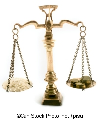 A pair of scales with rice and coins - ©Can Stock Photo Inc. / pisu