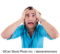 A man holding his head in despair - ©Can Stock Photo Inc. / alexandrenunes