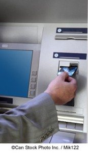Card being inserted into Cashpoint - ©Can Stock Photo Inc. / Mik122