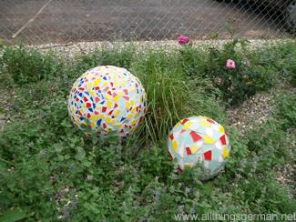 Mosaic balls in one of the flower beds at the Neckarbluehen Garden Show in Horb am Neckar 2011