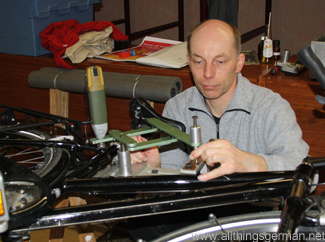 Andreas Ripken (ADFC) engraving a cycle frame during Tag des Fahrrads in Oberursel, February 2012