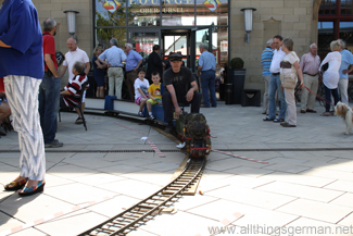 The miniature steam train in front of the Lounge entrance