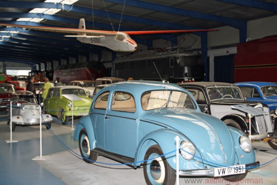 Cars and a glider inside the Railway and Technical Museum on Ruegen