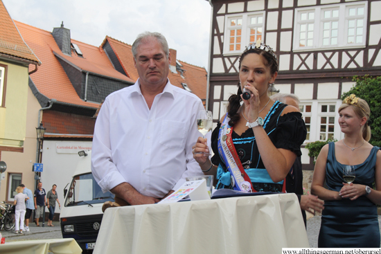 Brunnenkoenigin Vanessa I. with Brunnenmeister Harry Hecker at the opening of the wine festival