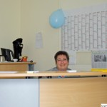 Manuela Eich at the desk in the entrance to the new volunteers' office