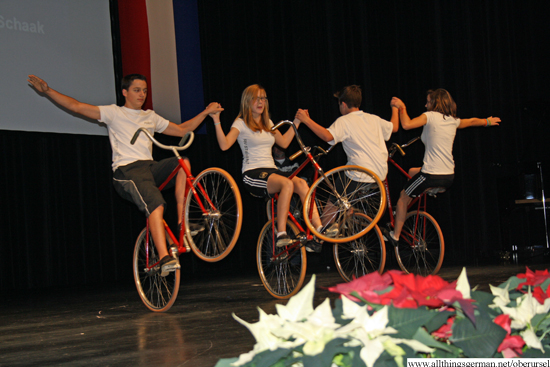 Members of the cycle club Fahr Wohl perform a demonstration of synchronised cycling
