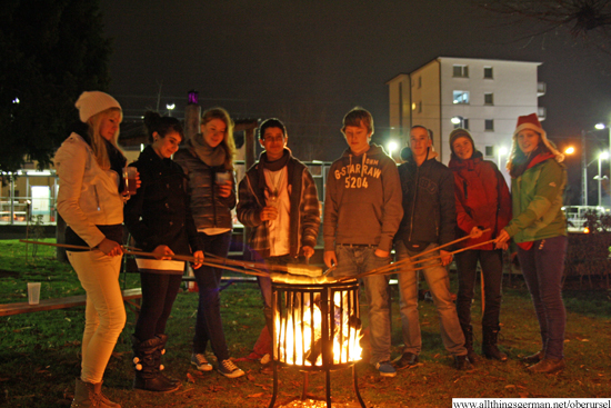 Part of the group around the fire with their twists