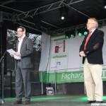 Daniel Rinck and Hans-Georg-Brum on stage opening the Ärtzehaus