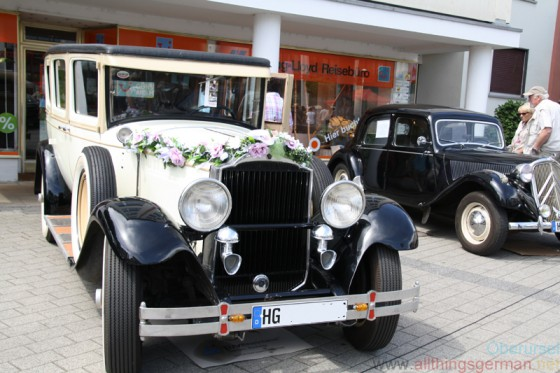 A vintage car on display at the Epinay-Platz during Autos in der Allee 2014