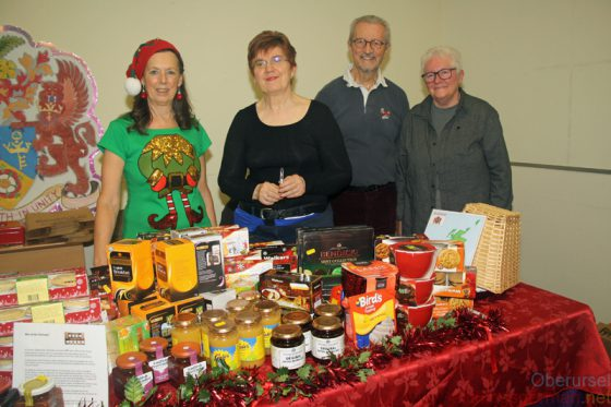 Selling their wares from Rushmoor in the town hall at Oberursel's Christmas market: June Smith (left), Veronica Graham-Green, Frank Rust and Carol Rust (right).