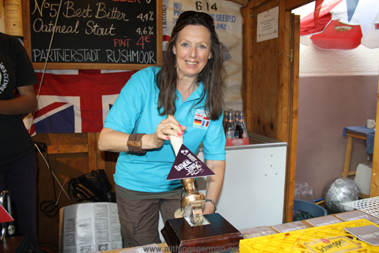 June Smith pulling a pint at the Rushmoor stand in the Weidengasse