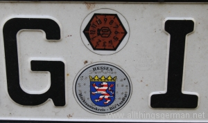 A German numberplate with emissions test sticker still in place