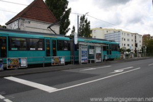 A U3 train waits to cross Kupferhammerweg in Oberursel during the Hessentag