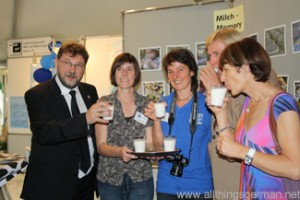 Volker Bouffier drinks a glass of milk at the Hessentag in Oberursel