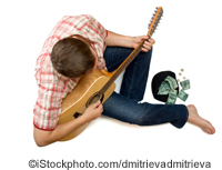 A street musician - ©iStockphoto.com/dmitrievadmitrieva
