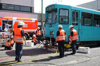 The fire brigade de-rail and then re-rail a tram.