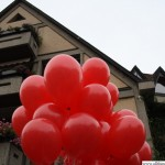Red balloons in front of the library