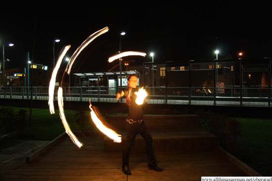 Judith Hildmann (rewadopo) with a hula hoop of fire