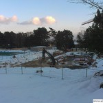 Building work continues in the snow on the new indoor pool