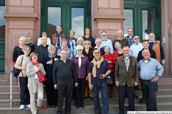 The classes of 1953 at their reunion on the school steps