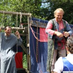 Marcus Keimling on the water guillotine with Annabel I. chosing which string to pull