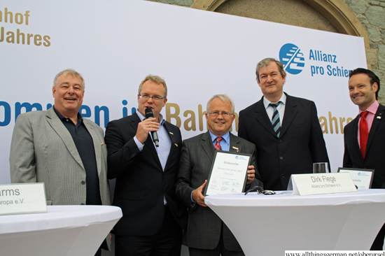 The certificate for Station of the Year being presented in Oberursel