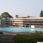 The outdoor pool and the building site