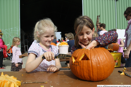Katharina (left) and Emma-Fee (right) carving a pumpkin at the maize maze on Sunday, 28th September, 2014