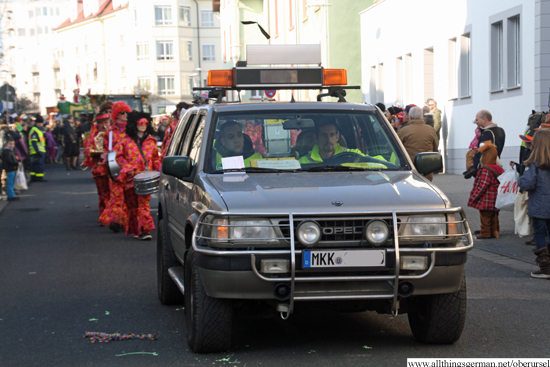 The Verkehrsüberwachungsclub at  the head of the 2015 carnival parade as it passes through the Henchenstraße