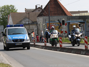 Police clear the road for the cycle race