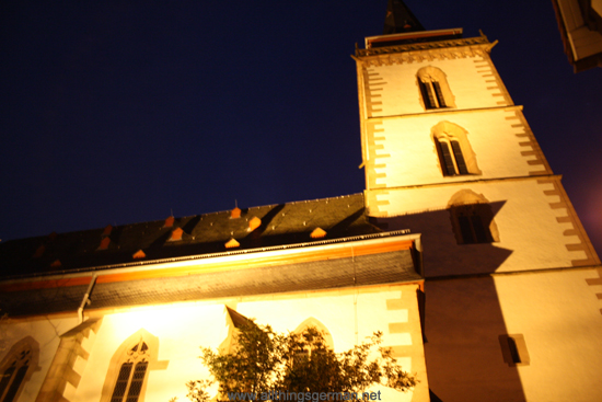 The St. Ursula Church in Oberursel during a full moon, coming from the Hollerberg