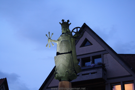 St. Ursula Fountain at the market square in Oberursel during a full moon