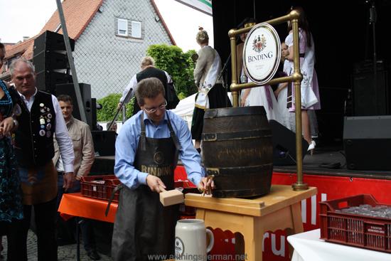 Alderman Christof Fink tapping a barrel of beer to open the Brunnenfest (Fountain Festival) 2012 in Oberursel