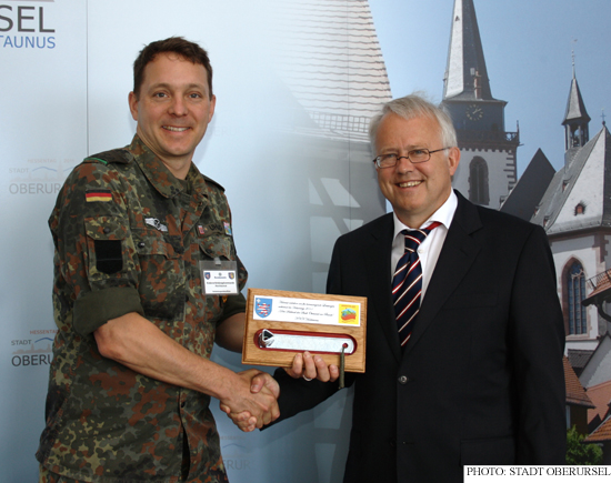Oberstleutnant (Lieutenant Colonel) Uhlig presenting the Town Key to Mayor Hans-Georg Brum